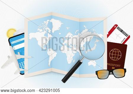 Travel Destination Japan, Tourism Mockup With Travel Equipment And World Map With Magnifying Glass O
