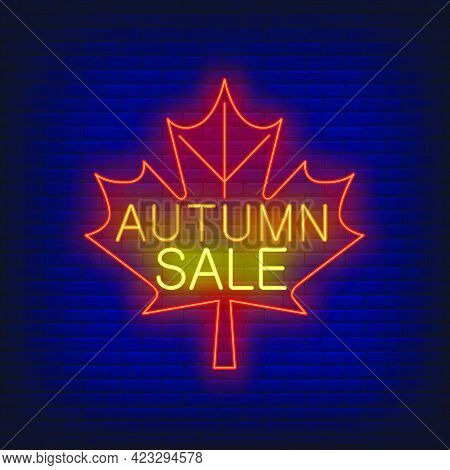 Autumn Sale Neon Lettering On Red Maple Leaf. Shopping, Discount, Sale Design. Night Bright Neon Sig