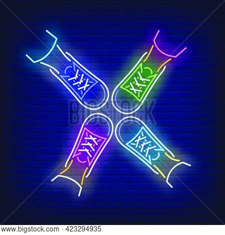 Four Feet Standing In Circle Neon Sign. Friendship, Unity, Advertisement Design. Night Bright Neon S