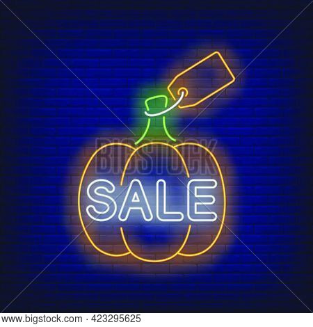 Pumpkin With Label Neon Sign. Glowing Neon Text. Pumpkin, Discounts, Thanksgiving Day. Night Bright