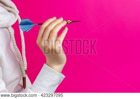 Darts Game. Dart For Playing Darts. Hand Holds A Dart. A Man Prepares To Throw A Dart.