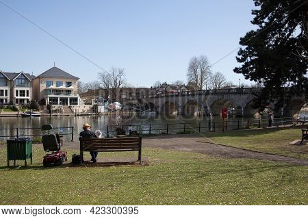 People Sat By The Thames At Bridge Gardens In Maidenhead, Berkshire In The Uk, Taken On The 30th Mar