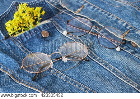 Eye Glasses And Yellow Wildflowers On The Pocket Of A Blue Denim Jacket, Trend Eye Glasses, Retro St
