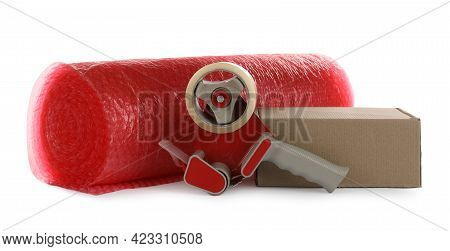 Bubble Wrap Roll, Cardboard Box And Tape Dispenser On White Background
