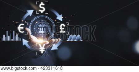 Businessman Holding Banking Icon With Currency Such As Dollar Yuan Pound And Euro , Currency Exchang