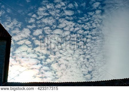 White Fluffy Clouds In The City With The Outline Of Houses. Summer Time Lapse. Cloud Time Lapse Natu