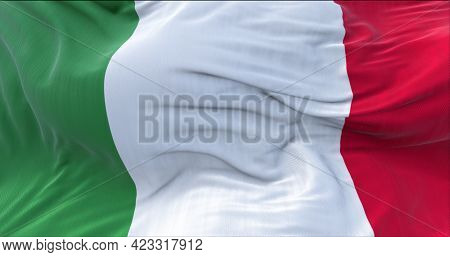 The Tricolor Flag Of Italy Waving In The Wind. Italian National Flag In Green, White And Red Vertica