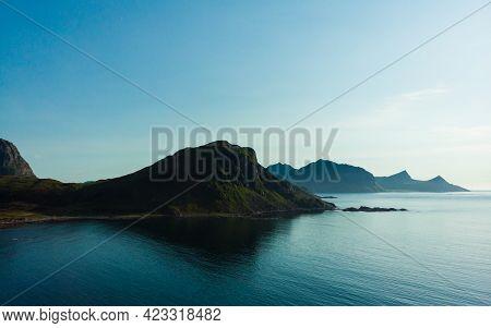 Coast Of Vestvagoy Island, Uttakleiv Location. Seascape With Scenic Rocky Shoreline And High Mountai