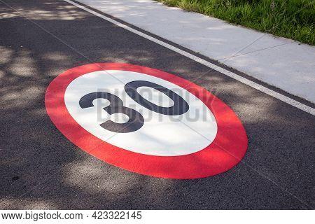 30 Kilometers Hour Speed Limit Sign Painted On Asphalting Road