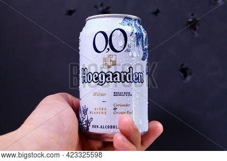 Tyumen, Russia-may 25, 2021: Hoegaarden Beer On Dark Background. Hoegaarden Is A Belgian Wheat Beer