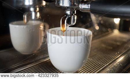 Cup Of Coffee In A Coffee Machine. The Process Of Preparing An Espresso Or Americano. Coffee Equipme