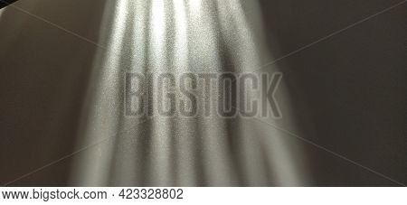 Abstract White Gray Background. Oblique Light Rays On A Gray Background With Flickering Dots. From L