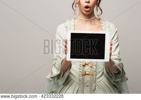 Cropped View Of Astonished Woman In Retro Dress Holding Digital Tablet With Blank Screen Isolated On