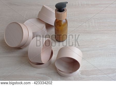 Cardboard Boxes Of Different Sizes And Colors With Natural Filling, A Large Piece Of Wrapping Paper,