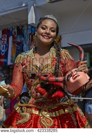 Arica, Chile - January 23, 2016: Young Women Performing The Diablada (dance Of The Devil) As Part Of