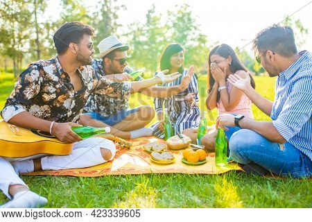 Oriental Ethnic Cheerful Friends At Pic-nic In Sammer Park