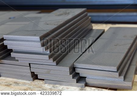 The Metal Parts Are Cleaned Of Jizz And Stacked On A Pallet. A Thick Sheet Of Metal Cut On A Plasma