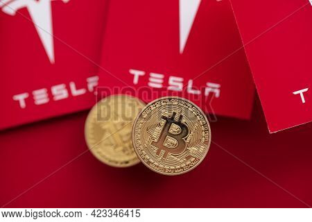 London, Uk - June 2021: Bitcoin Cryptocurrency On A Tesla Electric Vehicle Logo