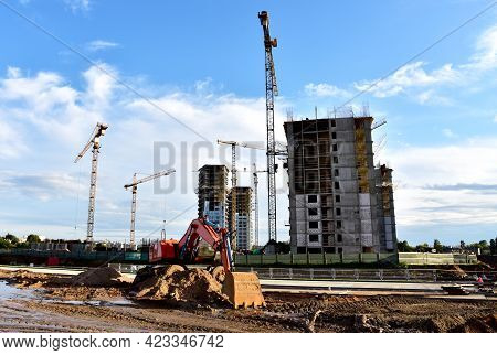 Excavator On Earthmorks At Construction Site. Backhoe Dig Ground For The Construction Of Foundation