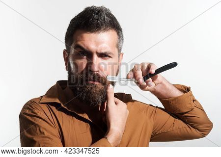 Bearded Man With Straight Razor For Shaving. Stylish Hairdresser With Barber Tools In Barbershop. Ba