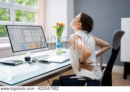 Back Pain And Bad Posture Stress At Office Computer