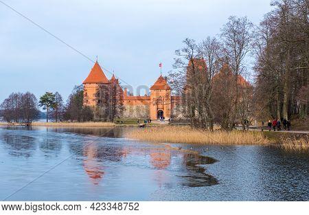 Trakai, Lithuania - February 16, 2020: Landscape Of Trakai Island Castle, Lake And Wooden Bridge At
