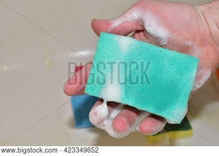Sponge With Detergent And Foam While Washing. Cleaning Kitchen, Bathroom Or Toilet. Wash Dishes And