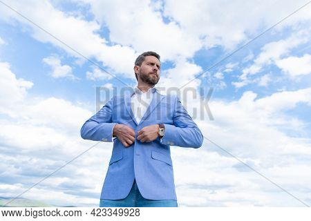 Handsome Mature Man Businessman In Suit Check Time On Wristwatch On Sky Background, Formalwear.