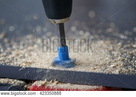 Drilling Through Holes In Chipboard With A Tool