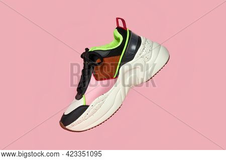Close-up Of The Right Shoe On A Pink Background. Bright Colors. Shoes For Sports