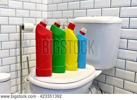 Detergent Bottles For Cleaning The Toilet In The Bathroom In Home. Detergents Bottles And Household