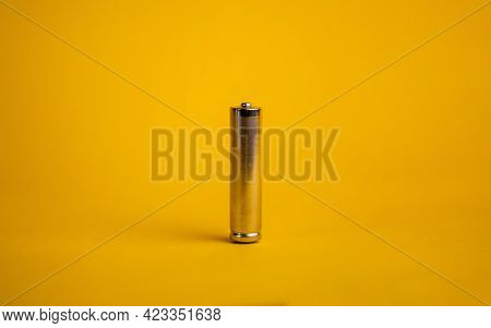Metal Aaa Battery On A Yellow Background.