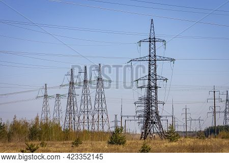 High Voltage Power Line On Industrial Electricity Line Tower. Energy Transmisson With Overhead Power