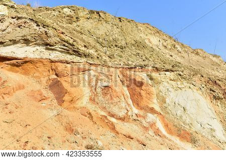 Land Structure In Open Pit Mining. Ground Background In Quarry. Rock Texture During Earthworks. Sand