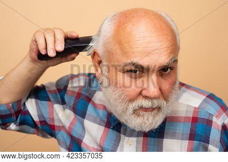 Man With Hair Clipper. Old Bald Man Hair Clipper, Mature Baldness And Hair Loss Concept.