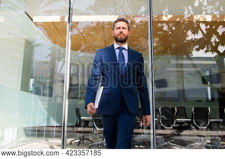 Businessman Walking. Urban Business Man. Casual Businessman Wearing Suit Jacket. Portrait Of A Matur