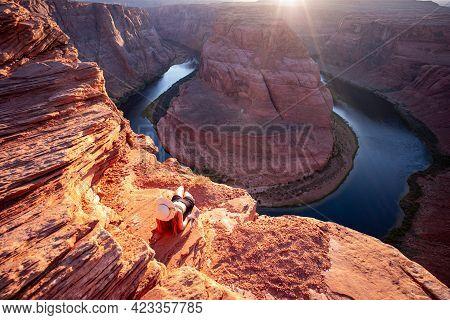 Young Woman Enjoying View Of Horseshoe Bend, Arizona. Dusk Photo Of Horseshoe Bend In Arizona United