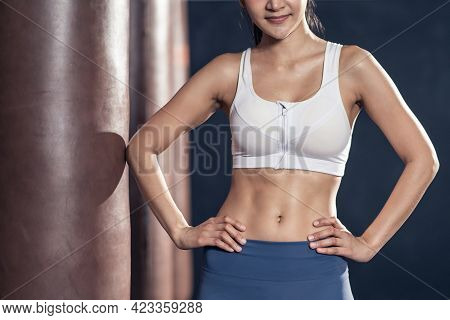 Close Up Of Athlete Fit And Firm Girl Stand With Confidence After Abdomen Cardio Workout Exercise In