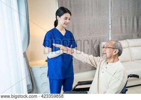Asian Young Beautiful Woman Nurse Carer At Nursing Home Take Care Disable Senior Elderly Man By Serv