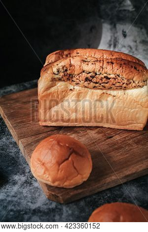 Fresh Homemade Loaf Of Bread With Truffle On Cutting Board. Bakery Gold Rustic Crusty Loaves Of Brea