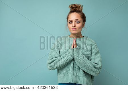 Photo Of Young Positive Beautiful Blonde Woman With Sincere Emotions Wearing Casual Blue Pullover Is
