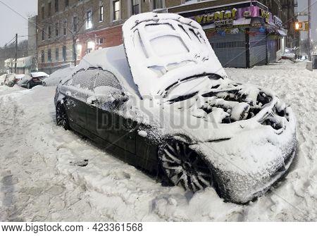 Bronx, New York/usa - February 1, 2021: Vehicle Stuck In Snow On Local Street.