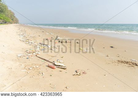 Trash On Tropical Beach. Plastic Pollution Environmental Problem. Plastic Bottles And Other Garbage