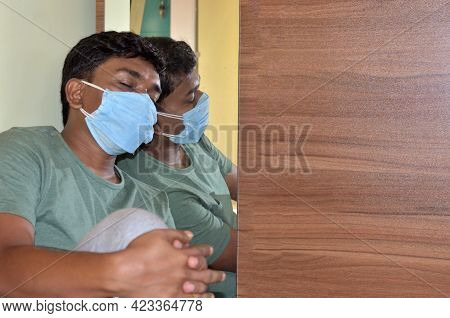 Covid-19, Self Isolation. Young Man Suffers From Loneliness While Being Quarantined. Man In Medical