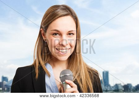 Woman talking on the microphone