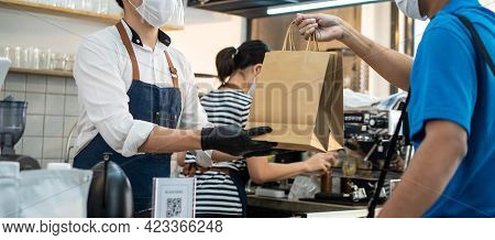 Asian Food Deliverly Man Wearing Protective Mask Due To Covid-19 Pandemic, Receive Beverage Order Fr