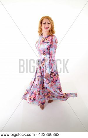Beautiful Female Model With Blonde Long Curly Hair Posing In Studio On A White Bacground In Nice Dre