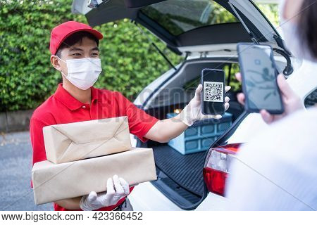 Postman Delivering Package Of Goods To Home. Young Asian Cute Girl Receiving Boxes From Postman At T