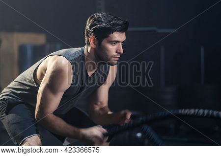Caucasian Young Handsome Active Male Athlete Or Sportsman Practicing Exercise By Using Battle Rope M