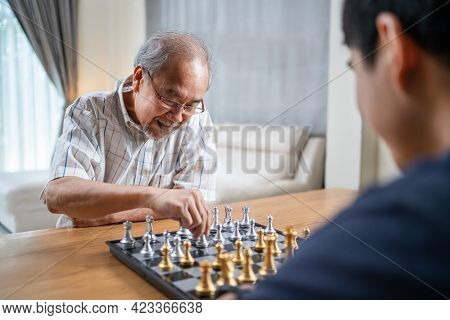 Asian Senior Elderly Male Spend Leisure Time, Stay Home After Retirement. Happy Smiling Old Man Enjo